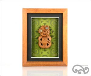 Framed tiki carving