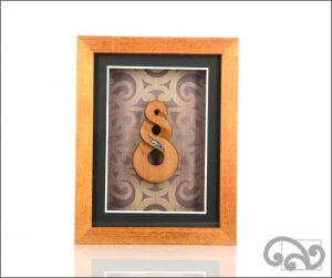 Framed Maori twist carving