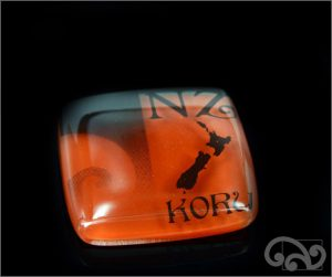 Koru glass note weight