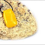 Yellow dichroic glass pendant.
