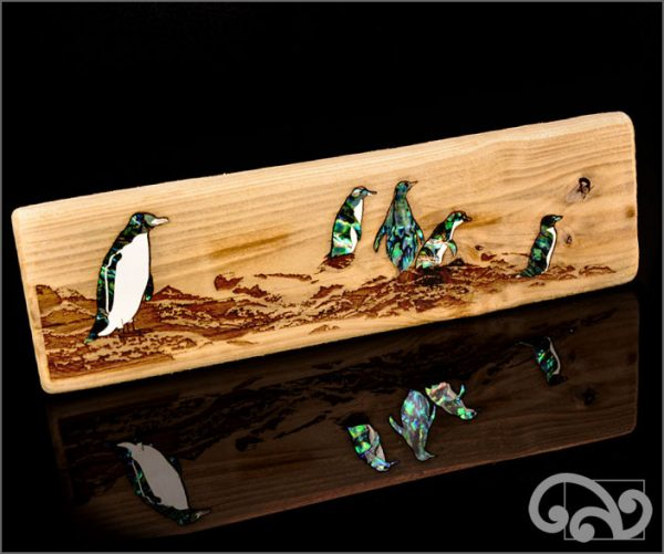 Recycled driftwood with penguins