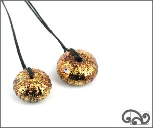 Small kina pendants with antique gold finish