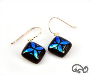 Blue glass earrings with tapa design