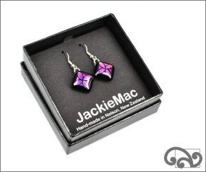 Purple glass earrings with tapa design