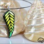 Golden fern glass pendant.