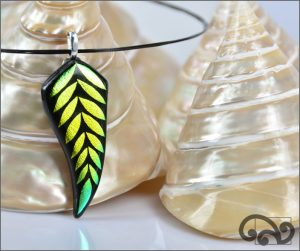 Golden fern glass pendant.
