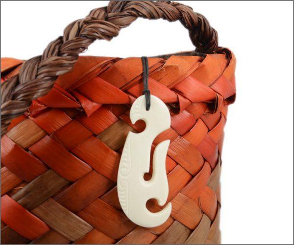 Contemporary fishhook bone carving