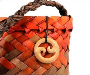 Double koru wood carving