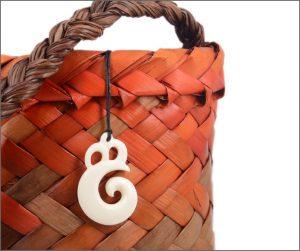 Manaia koru bone carving