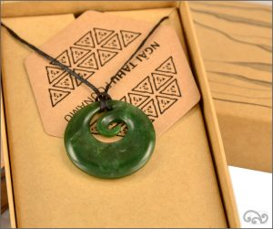 Medium authentic greenstone koru pendant