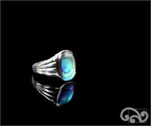 Silver ring with large oval natural paua piece