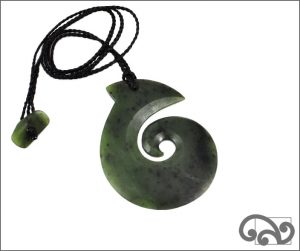 Large greenstone fishookm carving with koru