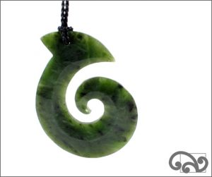 Large greenstone fishhook with koru