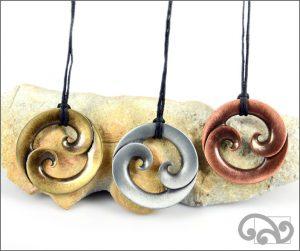 Round double koru zinc pendants