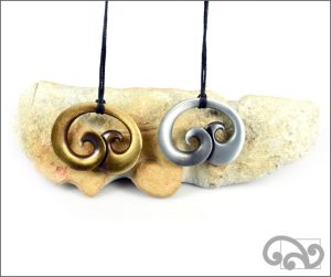 Double koru zinc pendants