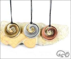 Single koru zinc pendants
