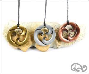 Triple koru zinc pendants