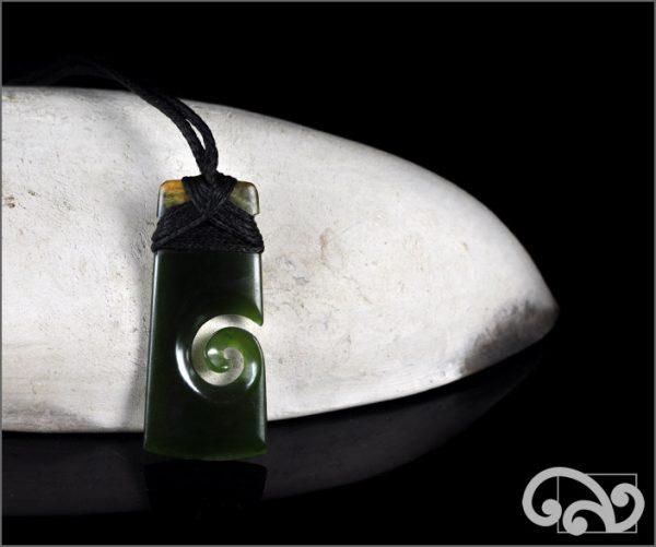 Greenstone adze koru pendant