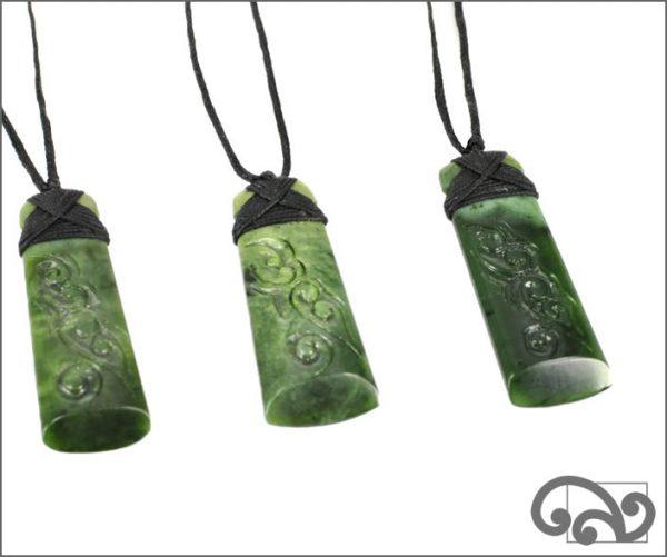 NZ greenstone toki with koru design