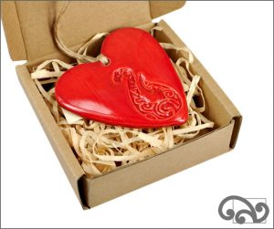 Red ceramic heart with fishhook