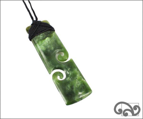 Pounamu toki double koru pendant
