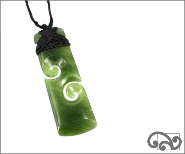 Greenstone adze with double koru