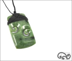 Greenstone adze with double koru